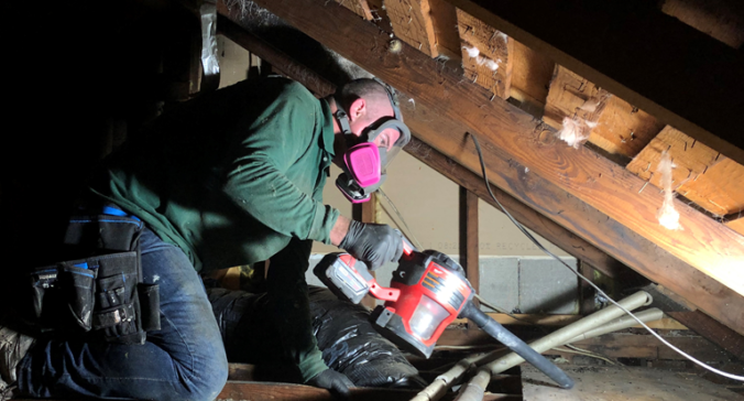 Cleaning a Seattle crawl space with a vacuum