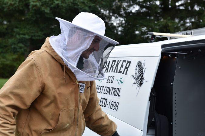 Pest control technician by Parker Eco Pest Control Truck, Washington